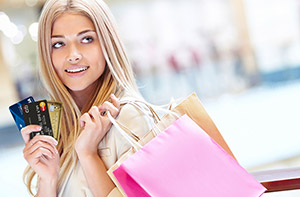 lady shoppign with credit cards
