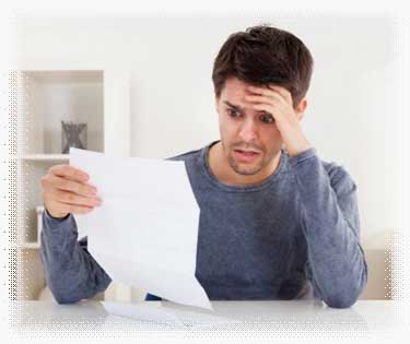 Guy holding his bill statement in shock