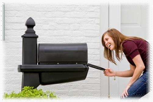 Lady opening her mailbox