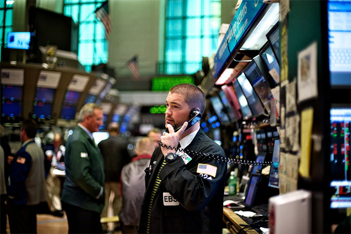 Man on phone at stock market