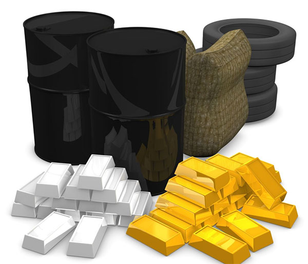 Gold and silver bars along with oil barrels